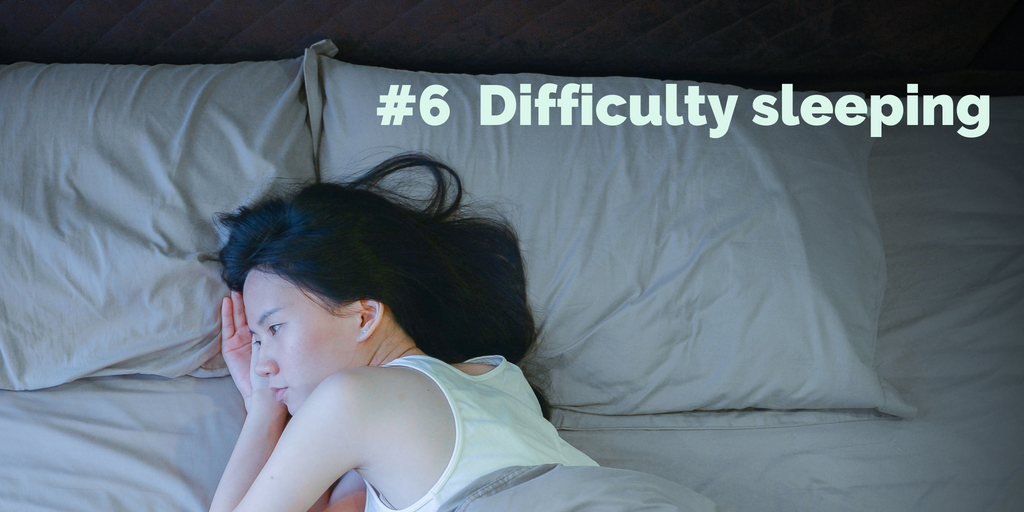 6-Difficulty sleeping. A woman lies awake, staring.