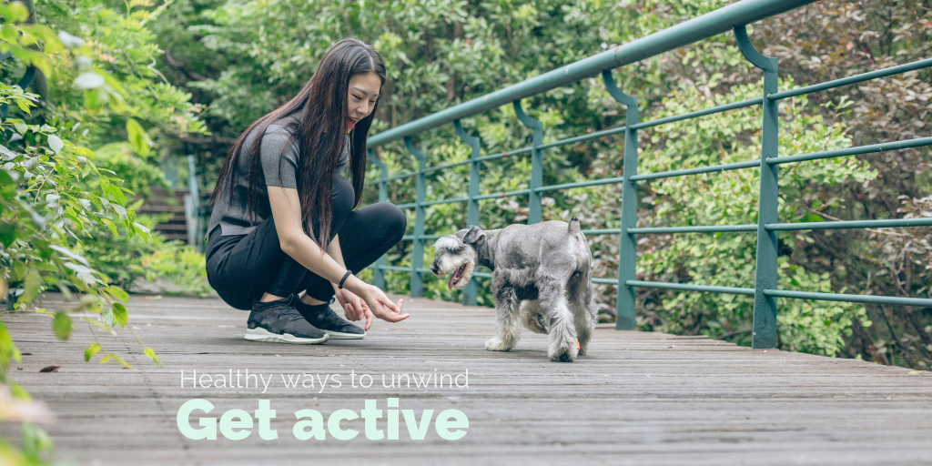 """Healthy ways to unwind: Get active"". A woman plays with her dog."