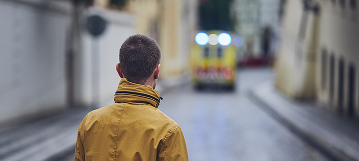 young-man-looking-at-leaving-ambulance-car-of-emergency-medical-service-concepts-health-care-rescue_t20_3wkEnN